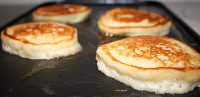 Yogurt Pancakes on the griddle | urbnspice.com