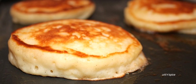 Fluffy Yogurt Pancakes on the griddle | urbnspice.com