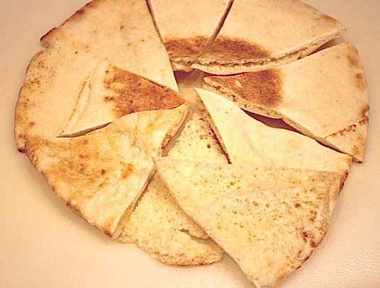 Parmesan Pita Crisps: 1st step cutting the pitas and separating the pieces into two   urbnspice.com
