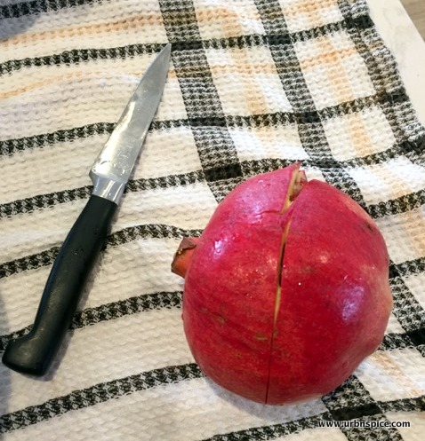 Scoring the outside rind of the Pomegranate