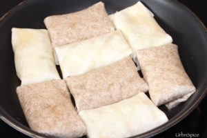 Place the burritos face down in frying pan and cook until golden brown | urbnspice.com