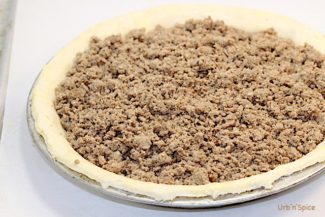 Filling pie shell with tourtiere filling | urbnspice.com