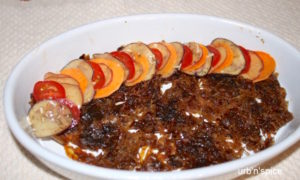 Layering the vegetables onto the Caramelized Onion Layer in the Vegetable Tian | urbnspice.com