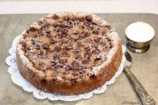 Garnish the Chocolate Cherry Almond Torte with a simple dusting of icing sugar and softly whipped cream | urbnspice.com