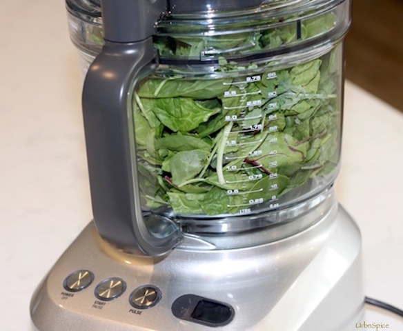 The Greens are stuffed into a food processor and ground finely | urbnspice.com