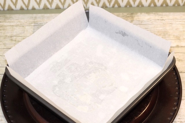 Lining the pan with parchment paper | urbnspice.com