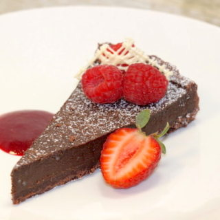 Plated Decadent Dark Chocolate Tart | urbnspice.com
