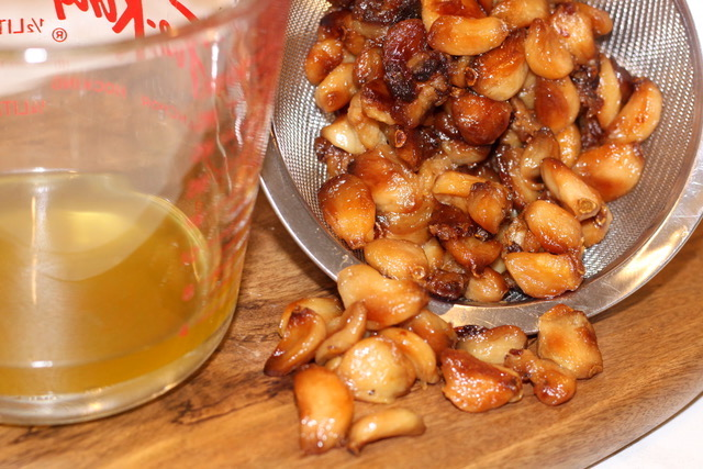 Straining the roasted garlic cloves | urbnspice.com