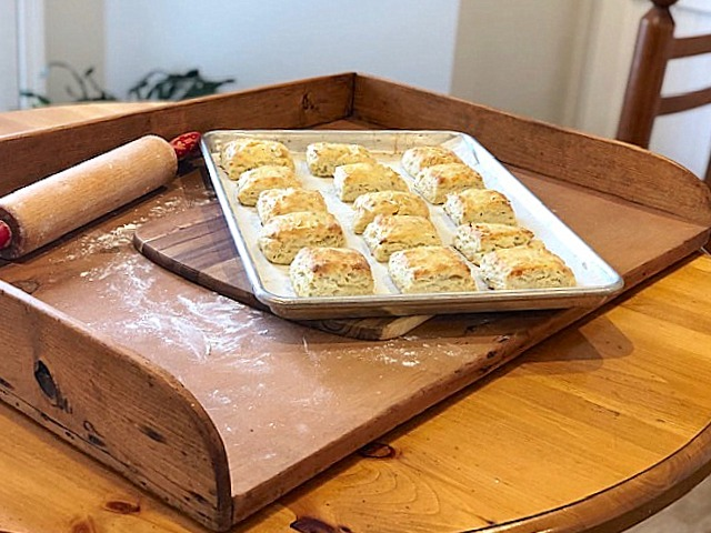 A tray of Asiago Cheese and Chive Scones cooling | urbnspice.com